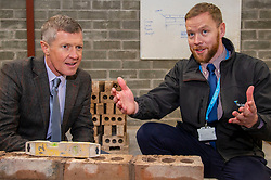 """Pictured: Willie Rennie is shown the basics of bricklaying by Marc Felmming, Academic Quality Manager at Fife Coillege<br /><br />Scottish Liberal Democrat Leader Willie Rennie visited the Future Energy Skills centre at Fife College in Glenrothes today to argue for """"astronomical investment"""" in home insulation to tackle the climate emergency and end fuel poverty by 2025 . <br /><br /><br /><br />Ger Harley 