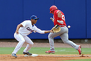 09 June 2012: NC State's Dany Canela (23) is called safe on this play, beating the ball to Florida first baseman Vicklash Ramjit (30). The University of Florida Gators defeated the North Carolina State University Wolfpack 7-1 at Alfred A. McKethan Stadum in Gainesville, Florida in Game 1 of their NCAA College Baseball Super Regional series.