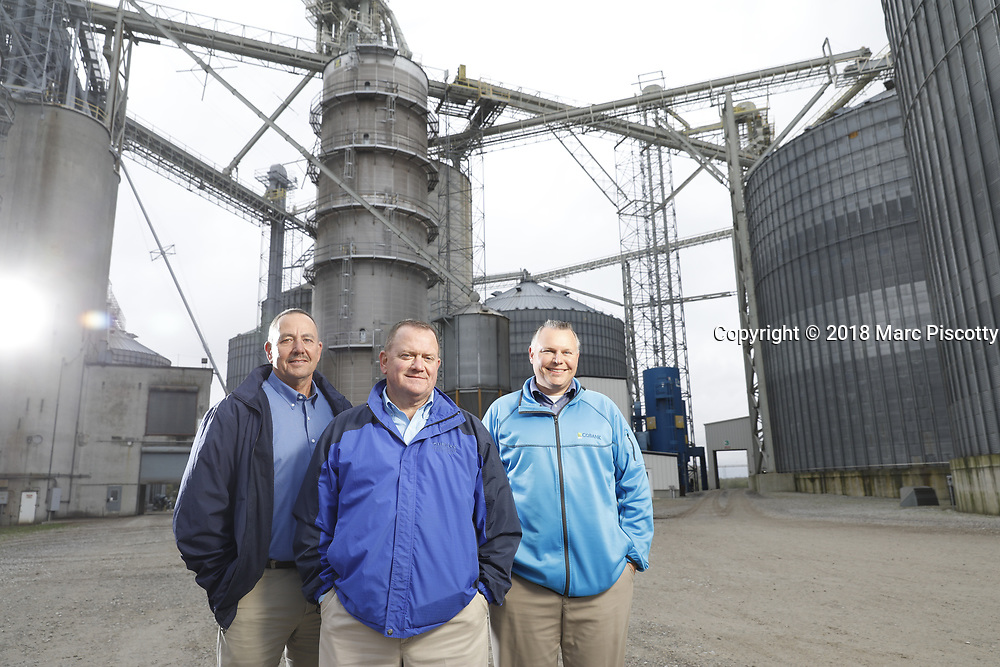 SHOT 10/29/18 9:54:58 AM - Sunrise Cooperative is a leading agricultural and energy cooperative based in Fremont, Ohio with members spanning from the Ohio River to Lake Erie. Sunrise is 100-percent farmer-owned and was formed through the merger of Trupointe Cooperative and Sunrise Cooperative on September 1, 2016. Photographed at the Clyde, Ohio grain elevator was George D. Secor President / CEO and John Lowry<br /> Chairman of the Board of Directors with  CoBank RM Gary Weidenborner. (Photo by Marc Piscotty © 2018)