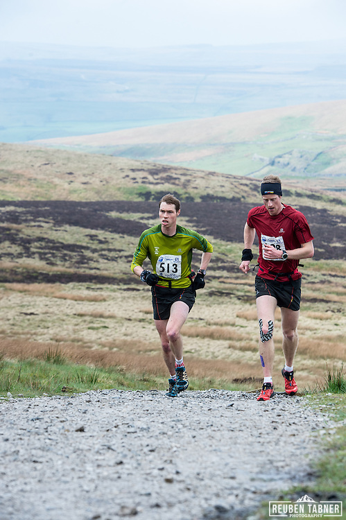 Runner 998 Ricky Lightfoot and 513, Tom Owens lead the 60th Yorkshire Three Peaks race as it starts the main climb up Pen-y-ghent in the Yorkshire Dales.