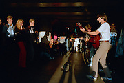 Saint Petersburg, Russia, August 2002..An impromptu concert by young buskers playing Beatles songs  gathers a crowd in a city centre subway.....