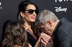 """File photo : Amal Clooney and George Clooney attend the premiere of Disney's Tomorrowland at AMC Downtown Disney 12 Theater on May 9, 2015 in Anaheim, CA, USA. Amal Clooney and her husband George are expecting twins, US media report. The babies are due in June, according to CBS's The Talk host Julie Chen. Another source close to the couple, quoted by People, said they were """"very happy"""". The Clooneys' representatives have not yet commented. Photo by Lionel Hahn/ABACAPRESS.COM"""