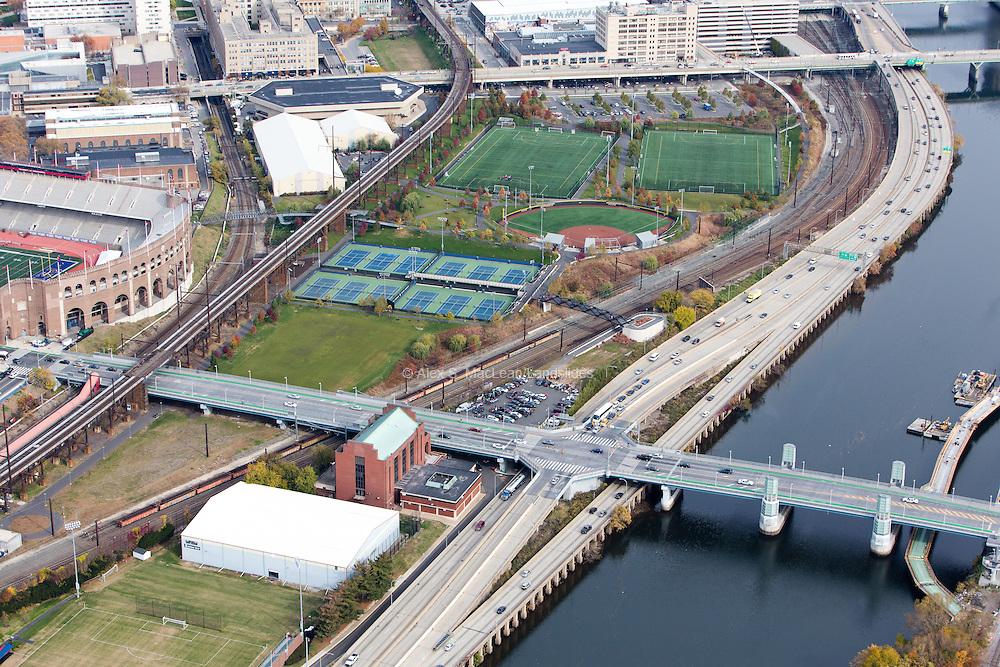 Penn Park, designed by Michael Van Valkenburgh Associates, sits between railroad lines and major roads