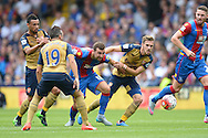 Aaron Ramsey of Arsenal pulls back James McArthur of Crystal Palace.Barclays Premier league match, Crystal Palace v Arsenal at  Selhurst Park in London on Sunday 16th August 2015.<br /> pic by John Patrick Fletcher, Andrew Orchard sports photography.