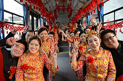 January 2, 2018 - Liaochen, China - Young couples wave to the photographer before participating in a group wedding in Liaocheng, east China's Shandong Province. (Credit Image: © SIPA Asia via ZUMA Wire)