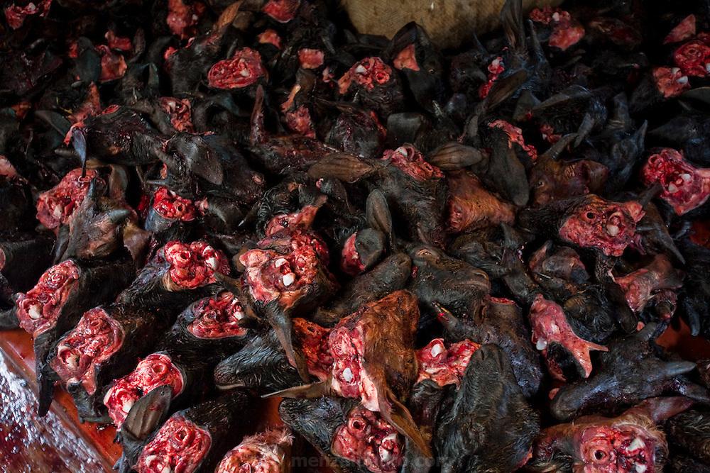A basketful of goat heads is displayed at the busy Santinagar Market in   Dhaka, Bangladesh.
