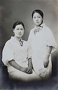 young Japanese women wearing kimono with apron begiinning of 1940s