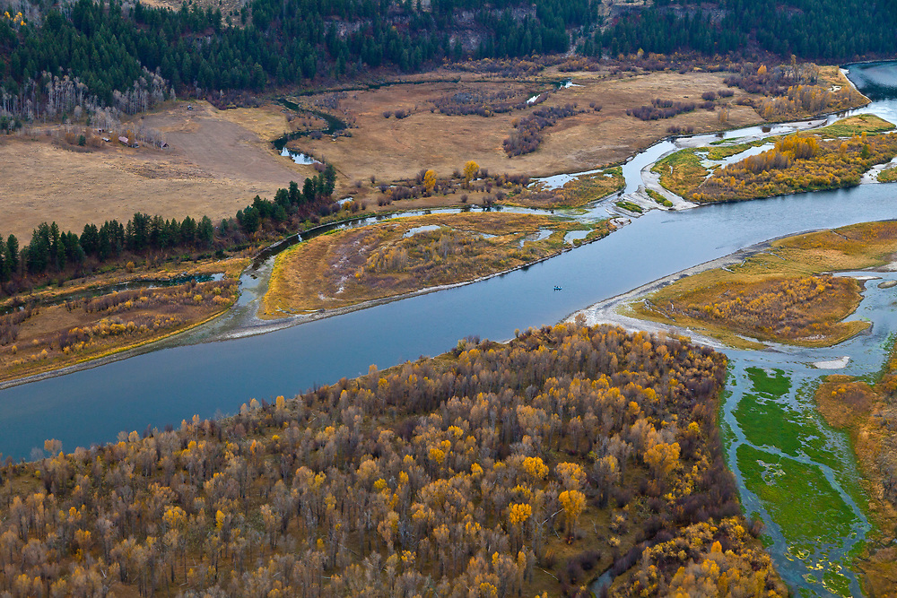 Aerial view of the Vardis Fisher homestead in upper left corner along the South Fork of the Snake River in Eastern Idaho near Swan Valley on a calm Autumn Day.  Licensing and Open Edition Prints