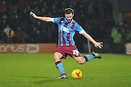 Jamie Ness of Scunthorpe United kicks forward  during the Sky Bet League 1 match between Scunthorpe United and Wigan Athletic at Glanford Park, Scunthorpe, England on 2 January 2016. Photo by Ian Lyall.