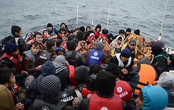Refugees are seen on a boat after they rescued by Turkish coast guards while they were illegally trying to reach Greece's Lesbos island through the Aegean Sea, in Canakkale province of Turkey on October 27, 2015. Refugees who begin a journey with a hope to have high living standards away from conflicts, use Greece's Lesbos Island as a transit point on their way to Europe. Photo by Ali Atmaca/AA/ABACAPRESS.COM  | 521549_025 Canakkale Turquie Turkey