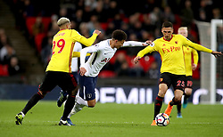 Tottenham Hotspur's Dele Alli (centre) battles for the ball with Watford's Etienne Capoue (left) and Jose Holebas
