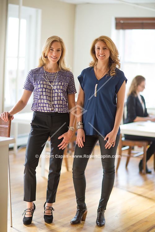 """NEW YORK, NY – OCTOBER 25, 2013: The opinion of Alexia Brue, left, and Melisse Gelula, right,  can make a New York boutique fitness studio – and seriously boost a vegan restaurant, workout wear brand or upstart natural skincare line. Their three-year-old Well+Good website/e-mail newsletter (""""your healthiest relationship""""), run out of a converted loft in a former Tribeca paper warehouse, is a must-read for green juice junkies and fitness addicts.<br /> <br /> Photo by Robert Caplin"""