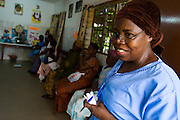 Nurse Konam Aya Marguerite stands in the waiting room of the NDA health center in Dimbokro, Cote d'Ivoire on Friday June 19, 2009.