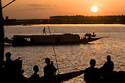 Children watching sunset at the riverside. At the confluence of the Niger and the Bani rivers, between Timbuktu and Segou, Mopti is the second largest city in Mali, and the hub for commerce and tourism in this west-african landlocked country.