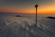 Travelers marker on the top of a mountain at winter time