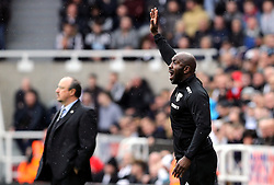 West Bromwich Albion caretaker manager Darren Moore and Newcastle United manager Rafael Benitez (background) on the touchline during the Premier League match at St James' Park, Newcastle.
