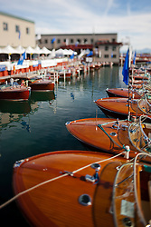 """""""Toy Boats at the Concours d'Elegance 2"""" - Photograph of classic wooden boats from the 2011 Tahoe Concours d'Elegance.  The toy boat effect was achieved using a tilt-shift lens."""