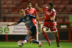 Charlton Athletic's Ben Reeves (left) and Crawley Town's Aryantaj Tajbakhsh battle for the ball