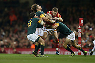 Liam Williams of Wales is stopped by Francois Venter (l), Rohan Janse van Rensburg © and Johan Goosen ® of South Africa. Under Armour 2016 series international rugby, Wales v South Africa at the Principality Stadium in Cardiff , South Wales on Saturday 26th November 2016. pic by Andrew Orchard, Andrew Orchard sports photography