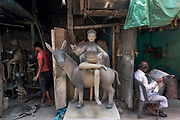 """The settlement of Kumartuli - or """"potter locality"""" - lies beside the Ganges in the older, northern part of Calcutta.Over 300 years old, today around 150 families live here, earning a living by sculpting idols for Durga Puja and various other festivals. Gangamaati - mud from the Ganges - is also used to make clay, and along with straw and bamboo the statues are crafted by hand."""