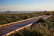 Late afternoon sun at Myrtle Beach State Park with pier and Boardwalk