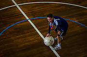 The Power Soccer Rio de Janeiro team's coach gives guidance to the athletes during a training session.