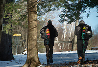 """Due to Covid 19 """"work from home"""" restrictions Eric Benevides and Scott Jarvis now take their daily lunch breaks at the Chris Daigle Disc Golf Course in Bolduc Park   (Karen Bobotas Photo/for The Laconia Daily Sun)"""