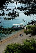 Elevated view of water taxi boat on beach Zlatni Rat, near village of Bol, island of Brac, Croatia