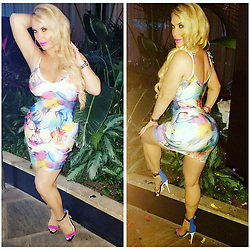 """Coco Austin releases a photo on Twitter with the following caption: """"""""Colorful for the 4th of July weekend!🎉🎉🎉"""""""". Photo Credit: Twitter *** No USA Distribution *** For Editorial Use Only *** Not to be Published in Books or Photo Books ***  Please note: Fees charged by the agency are for the agency's services only, and do not, nor are they intended to, convey to the user any ownership of Copyright or License in the material. The agency does not claim any ownership including but not limited to Copyright or License in the attached material. By publishing this material you expressly agree to indemnify and to hold the agency and its directors, shareholders and employees harmless from any loss, claims, damages, demands, expenses (including legal fees), or any causes of action or allegation against the agency arising out of or connected in any way with publication of the material."""