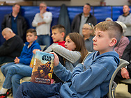 Merrick, New York, U.S.  December 20, 2019.  L-R, front row, brothers STEVEN STRAUS, 9, and RICHIE STRAUS, 10, and siblings SAMANTHA LEFEBURE, 9, and JAKE LEFEBURE, 10, who is holding the new Star Wars YA novel, all 4 friends from West Babylon, listen to author Kevin Shinick at book signing for his STAR WARS: FORCE COLLECTOR at North Merrick Library on Nassau County Force Collector Day. Author Shinick named home planet of Karr Nuq Sin, the main character of this official canon Star Wars young adult novel, MEROKIA in honor of Merokee tribe who settled his Merrick hometown on Long Island.