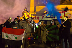 London, November 05 2017. Anti-capitalists gather in Trafalgar Square, London for the annual 'Million Mask March' which happens on November 5th every year, with many of the protesters donning 'V' For Vendetta Guy Fawkes masks. Past marches have turned violent with police horses shot by fireworks and police vehicles burned. PICTURED: Protesters let off smoke bombs in Trafalgar Square . © Paul Davey