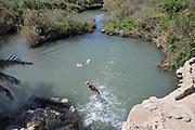 Israel, Maagan Michael, Nahal Taninim - Crocodile River national park, boy dives into the water