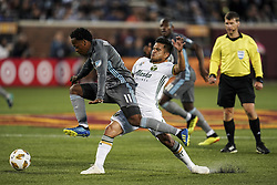 September 22, 2018 - Minneapolis, MN, USA - Minnesota United midfielder Romario Ibarra leaps into air while chasing the ball under the defense of Portland Timbers midfielder Andres Flores (14) in the first half on Saturday, Sept. 22, 2018, at TCF Bank Stadium in Minneapolis. (Credit Image: © Aaron Lavinsky/Minneapolis Star Tribune/TNS via ZUMA Wire)