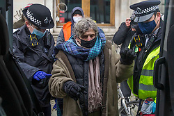 © Licensed to London News Pictures.31/01/2021, London,UK. Police remove a protestor as the eviction of HS2 Rebellion group from Euston Square Gardens in central London continues. Eco-activists are living in increasingly unstable tunnels beneath the square. Photo credit: Marcin Nowak/LNP