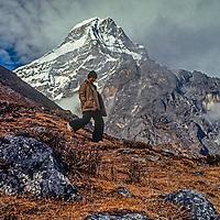 A trekker descends a hill below Kusum Khanguru in the remote Hinku Valley, east of the Khumbu region of Nepal's Himalaya.