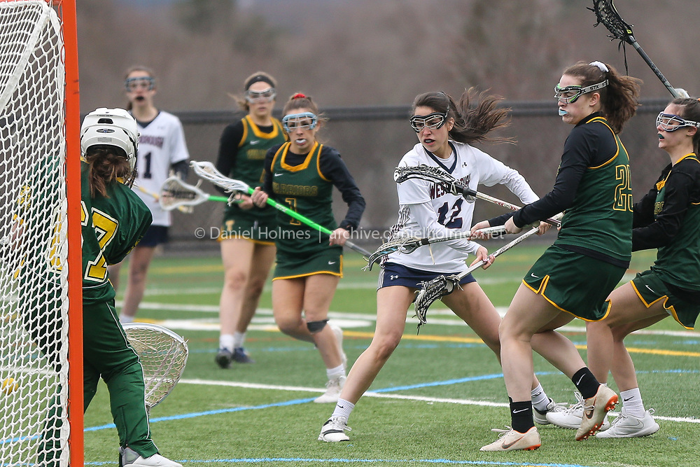 (4/5/19, WESTBOROUGH, MA) Westborough's Audrey Herzig shoots and scores during the girls lacrosse game against Tantasqua at Westborough High School on Friday. [Daily News and Wicked Local Photo/Dan Holmes]
