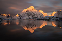 Olstind mountain peak winter reflection in Reine harbor, Moskenesøy, Lofoten Islands, Norway, Bay, Harbor, Reine, Reinefjord, Olstind, Olstinden, Calm, Tranquil,