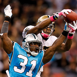October 3, 2010; New Orleans, LA, USA; Carolina Panthers cornerback Richard Marshall (31) breaks up a pass intended for New Orleans Saints wide receiver Marques Colston (12) during the second half at the Louisiana Superdome. The Saints defeated the Panthers 16-14. Mandatory Credit: Derick E. Hingle