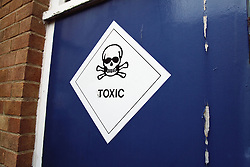 Sign on a door warning of toxic materials,
