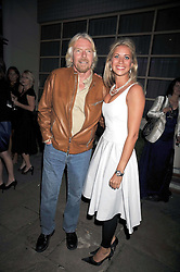 SIR RICHARD BRANSON and his daughter HOLLY BRANSON at The Ralph Lauren Sony Ericsson WTA Tour Pre-Wimbledon Party hosted by Richard Branson at The Roof Gardens, London on June 18, 2009