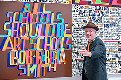 "© Licensed to London News Pictures. 04/09/2018. LONDON, UK.  Celebrated artist Bob and Roberta Smith RA, poses with his new work ""The Secret of a Good Life"", the first display by a Royal Academician in the new Ronald and Rita McAulay Gallery, a new space dedicated to site-specific installations by Royal Academicians in the new Royal Academy in Piccadilly.  This and other works are on display 4 September to 3 February 2019.  Photo credit: Stephen Chung/LNP"