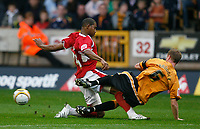 Photo: Steve Bond/Sportsbeat Images.<br /> Wolverhampton Wanderers v Bristol City. Coca Cola Championship. 03/11/2007. Marvin Elliott (L) is tackled by Jody Craddock (R)