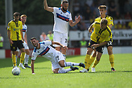 Bradden Inman is fouled during the EFL Sky Bet League 1 match between Burton Albion and Rochdale at the Pirelli Stadium, Burton upon Trent, England on 4 August 2018.