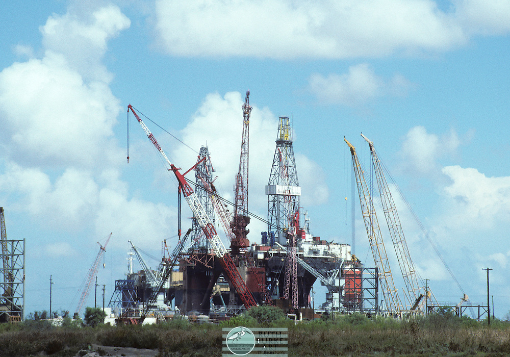 An oil platform, (offshore platform or colloquially oil rig) is a large structure with facilities to drill wells, to extract and process oil and natural gas, and to temporarily store product until it can be brought to shore for refining and marketing. In many cases, the platform contains facilities to house the workforce as well.<br /> Depending on the circumstances, the platform may be fixed to the ocean floor, may consist of an artificial island, or may float. Remote subsea wells may also be connected to a platform by flow lines and by umbilical connections. These subsea solutions may consist of one or more subsea wells, or of one or more manifold centres for multiple wells.