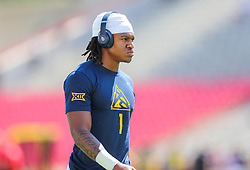 Sep 4, 2021; College Park, Maryland, USA; West Virginia Mountaineers wide receiver Winston Wright Jr. (1) warms up prior to their game against the Maryland Terrapins at Capital One Field at Maryland Stadium. Mandatory Credit: Ben Queen-USA TODAY Sports