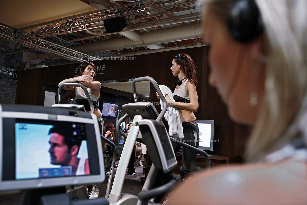 Italy, Florence, Fortezza da Basso, Fitfestival, people can tests the new fitness machine inside the large area dedicated to the trade fair
