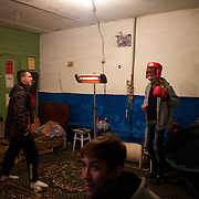 DONETSK, UKRAINE - OCTOBER 19, 2014: Local youngster relax inside a shelter under a block of apartments in Central Donetsk. CREDIT: Paulo Nunes dos Santos