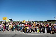 The event is over and people gather outside the gates in New Preston Road, Lancashire, United Kingdom, June 29th 2018.  Block Around the Clock - a fourty eight hours of event with work shops, yoga, sleeping and anti-fracking campaigning in front of the gates to Cuadrillas fracking site in Lancashire. The event was organised by anti-fracking campaigners in spite of an injunction granted to Cuadrilla to prevent protest against the impending shale gas exploitation. The Cuadrilla site in Lancashire in a highly contested site, almost ready to drill for gas.