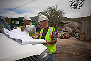 Juan Mata, left, and Esqui Padilla (CQ) go over plans the Carnuel Water Systems Improvement Project on August 27, 2010. The $3.4 million project is supported by $2 million from the American Recovery and Reinvestment Act and will provide clean water to hundreds of Bernalillo County residents.