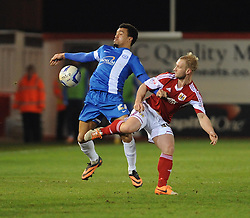 Peterborough United's Nicky Ajose is challenged by Bristol City's Simon Gillett - Photo mandatory by-line: Dougie Allward/JMP - Mobile: 07966 386802 11/03/2014 - SPORT - FOOTBALL - Peterborough - London Road Stadium - Peterborough United v Bristol City - Sky Bet League One